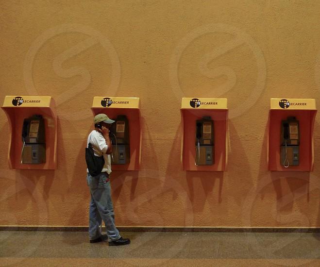 Man using public phone in Panama photo