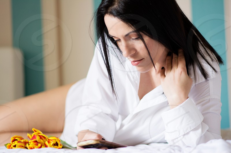 Woman in bed in the morning photo