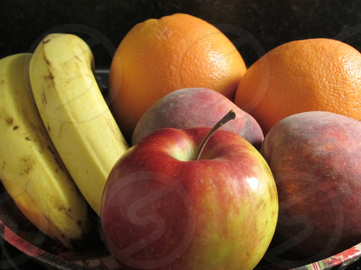 apple peach oranges and banana fruit on plate photo