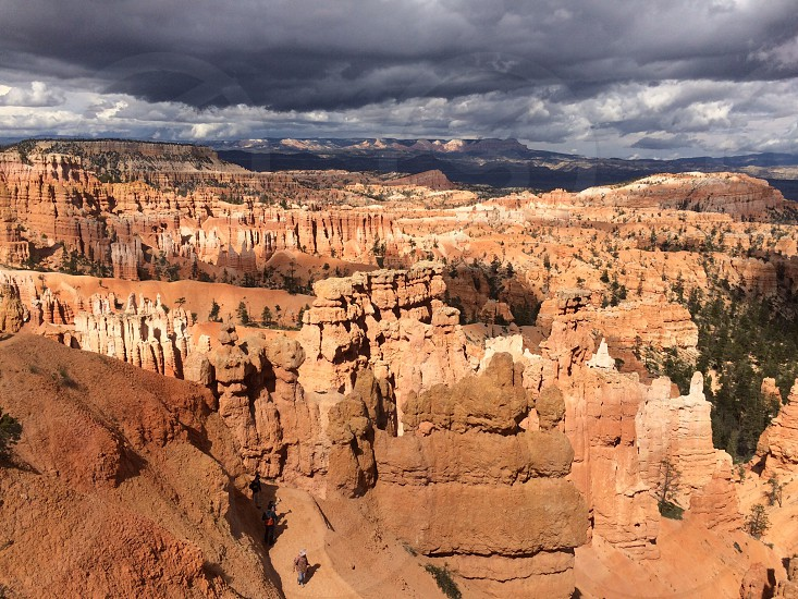 Bryce canyon National Park Usa rock formation geology clouds arid trees incidental people travel photo