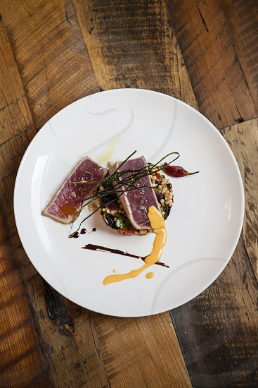 ahi tuna fresh caught fish courses plated dinner chef restaurant main course rare photo