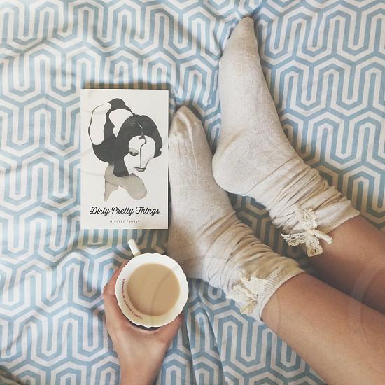 Tea socks snuggle cosy winter reading warm comfortable teatime feet  photo