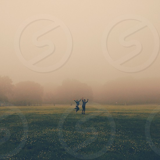 2 people on green grass field photo