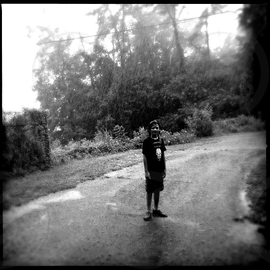 Boy in the Rain / Black and White photo