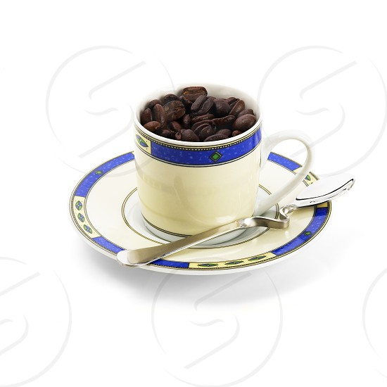 cup of roasted coffee beans isolated on white background photo