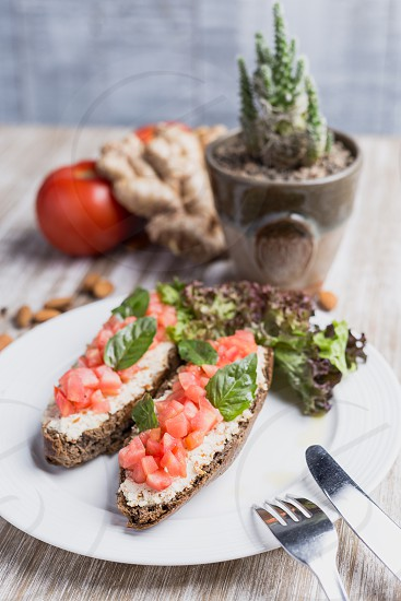 Two bruschettas ginger tomatoes and cactus photo