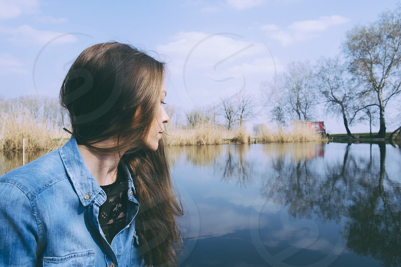 Woman relaxing at the lake photo