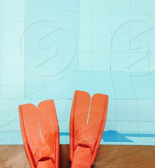 red diving flippers by the pool photo