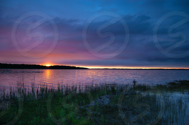 A Michigan sunrise is enhanced by an incoming storm. photo