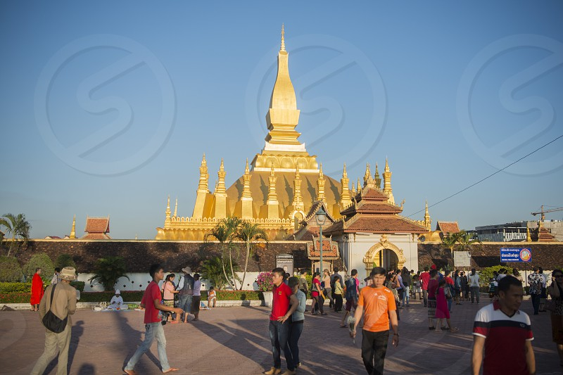 the Pha That Luang in the city of vientiane in Laos in the southeastasia. photo