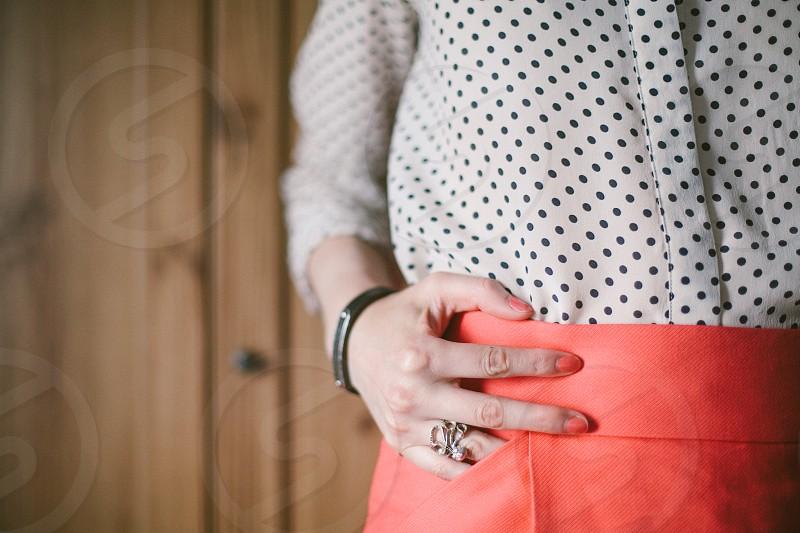 Polka dots. Matching coral nails and skirt. Octopus ring. photo
