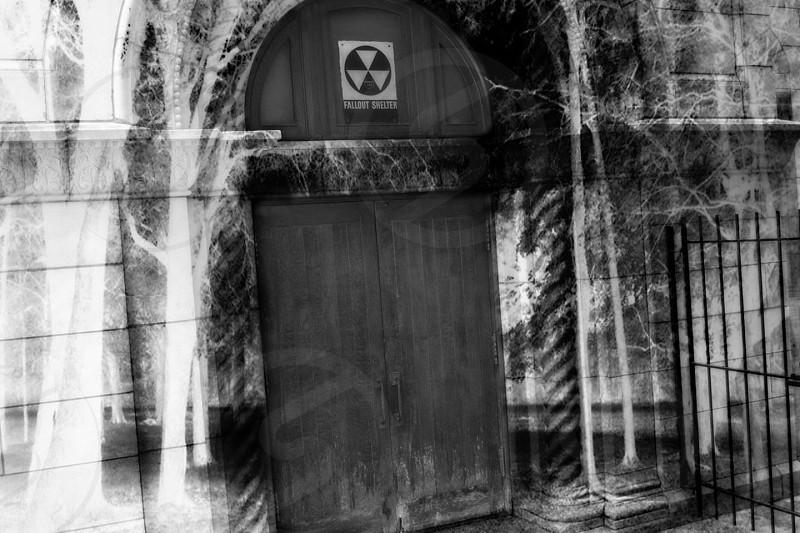 brown wooden door with hazard sign photo