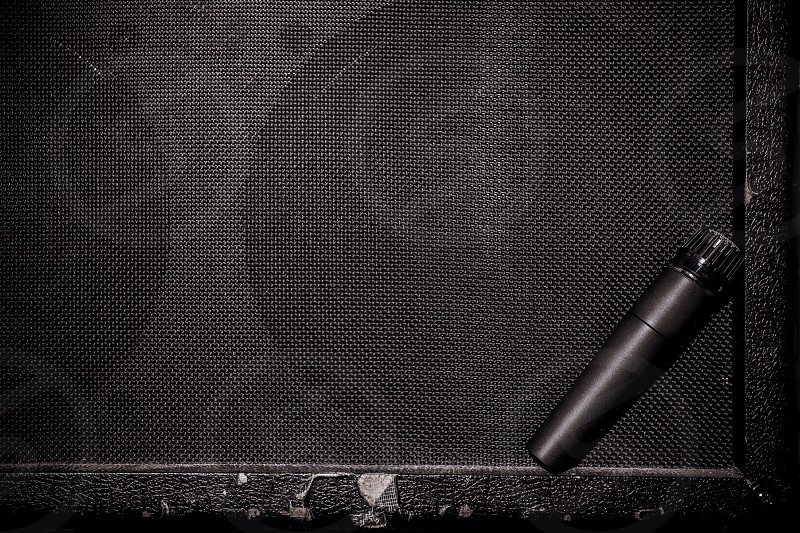 Microphone leaning on amp. Great for upcoming concert setlist bands opening mic night. photo