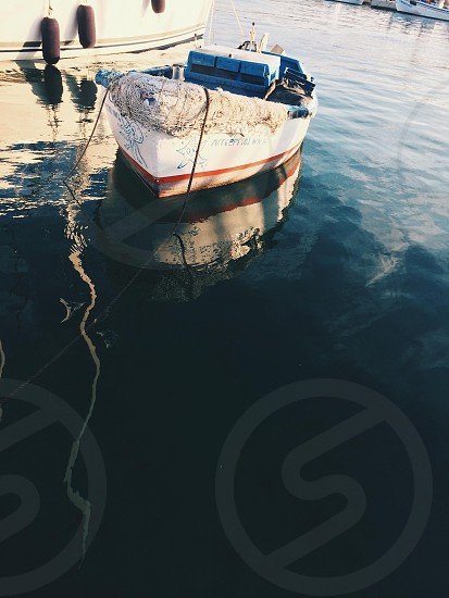 Small dinghy fishing boat photo