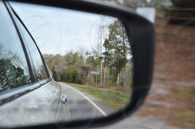 The journey begins! Watching through the side mirror as we cruise ahead to our destination. #Roadtrip #Car #Mirror #SideMirror #Lookback #Journey #Destination #Trip #Vacation #road photo