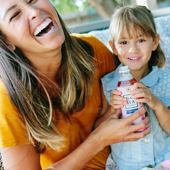 mother and daughter drinking on a porch teas tea photos photo