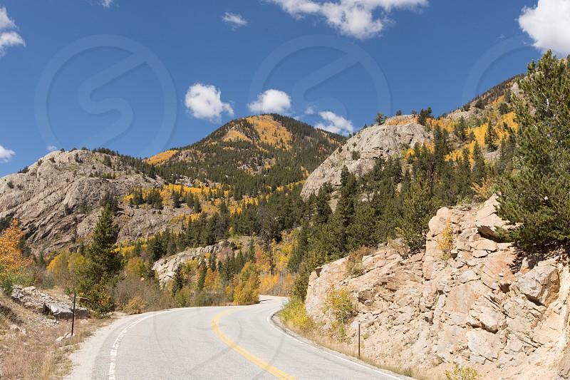 A twisting road through the fall foliage of Colorado photo
