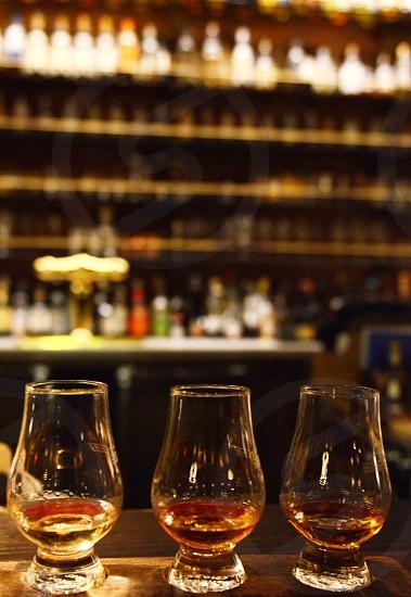 Whiskey flight bottles bar scotch rye Irish  photo