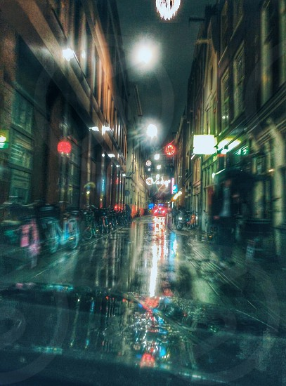 Driving thru an alley in Amsterdam in the rain. photo