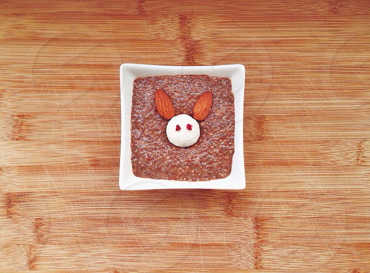 square designed with almonds on table photo