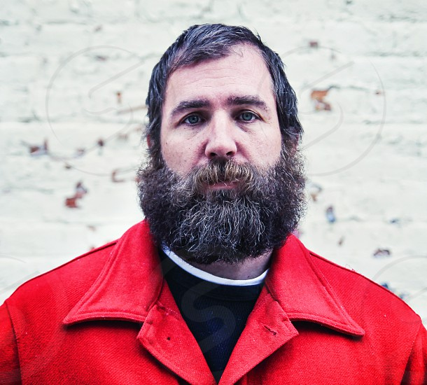 portrait hairy man beard man male hipster urban mustache sad human coat red winter cold homeless depressed person compassion mindful empathy    photo
