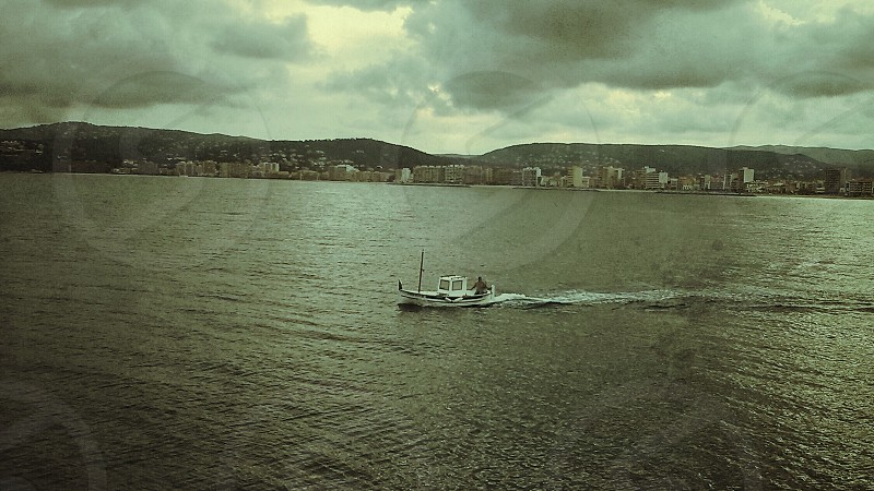 sea ocean fishing boat photo