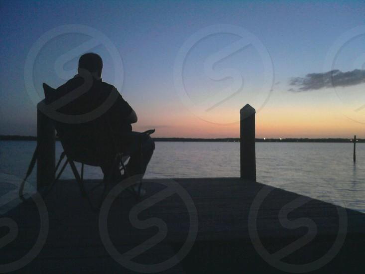 Reading at sunset on Tampa Bay. Oldsmar FL photo