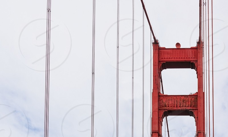 tower detail of the famous Golden Gate Bridge in San Francisco photo