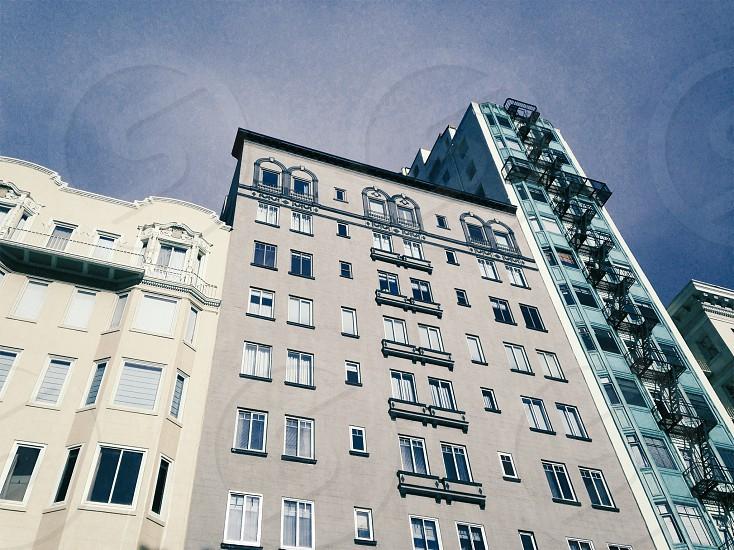 beige concrete high rise building photo