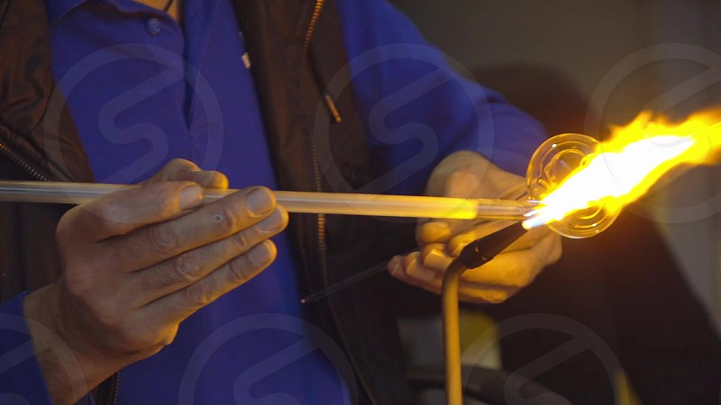 Glassworks manufacturing process . Handcraft poduction of glass teapot. Molten glass with open fire. Process of creating glass products step by step. Full HD video 240 fps 1080p. photo