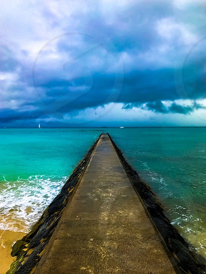 Walking the beach in Waikiki Hawaii just before the storm photo