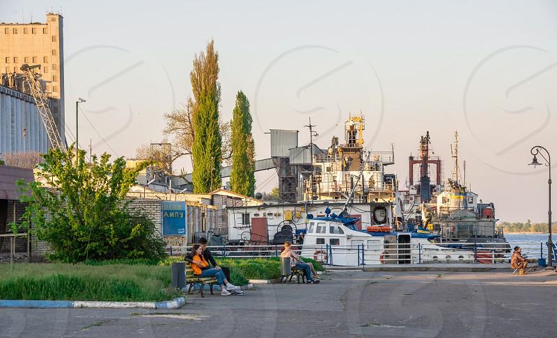 Kherson Ukraine - 04.27.2019. People walk and relax on the promenade in Kherson Ukraine photo