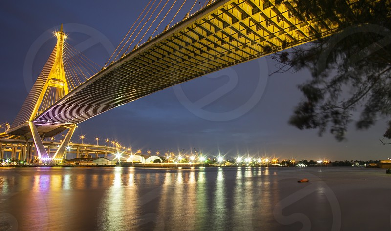 Bhumibol Bridge Chao Phraya River Bridge. Turn on the lights in many colors at night. photo