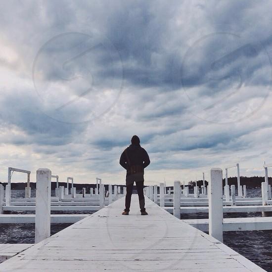 man standing on dock photo