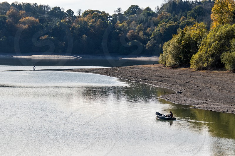 ARDINGLY SUSSEX/UK - NOVEMBER 2 : Man fishing at the reservoir in Ardingly Sussex on November 2 2018. Two unidentified people photo