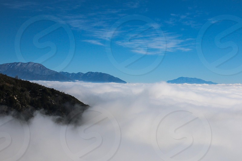 On top of the world. Mountains and clouds.  photo