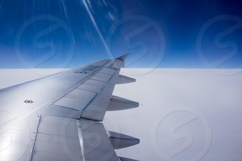 grey airplane on sky photo
