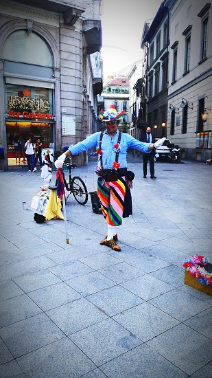 This clown gifted me a beautiful smile for a while in this sunny afternoon in Milano thanks to his irony and his colorful outfit 😍😍 photo