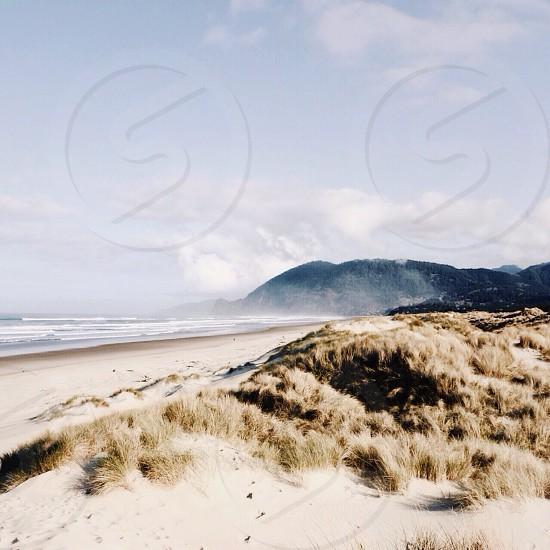 black mountain and white sand photo