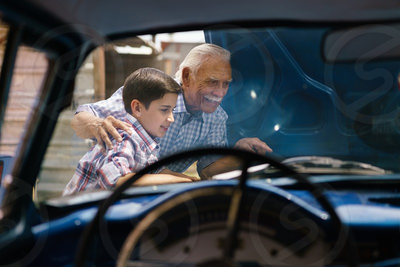 kid help grandfather grandpa repair broken car boy child auto people learning active adjust affectionate age difference american automobile cooperation elderly engine examining explaining family fixing generation gap grandchild grandparent grandson happy hispanic hood latin american learn listening man motor old retired retirement senior smile teaching together transportation two people vehicle vintage years young photo