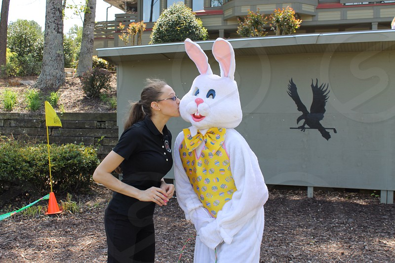 woman in black hugging person in bunny costume photo