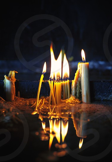Details from an Orthodox church group of candles for the dead.  photo
