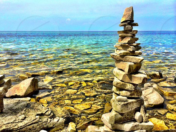 Stones lake water stacked photo