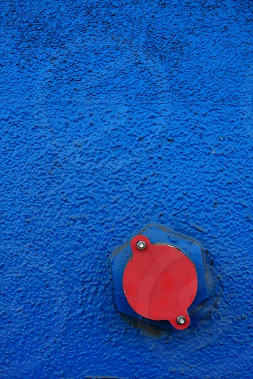 Fire hydrant on a blue wall photo