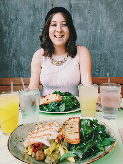 woman smiling sitting at restaurant table photo