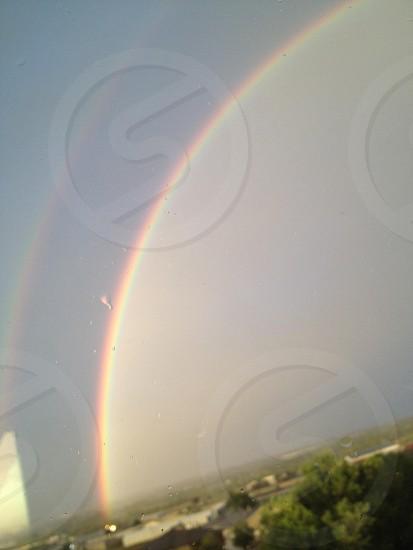 Double rainbow with rain drops photo
