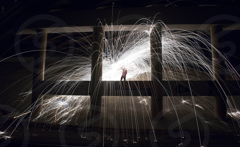 sparks steel wool bridge supports fireworks exciting swinging blue photo