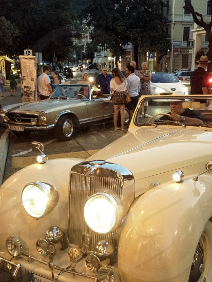 Classic cars coastal night shine photo