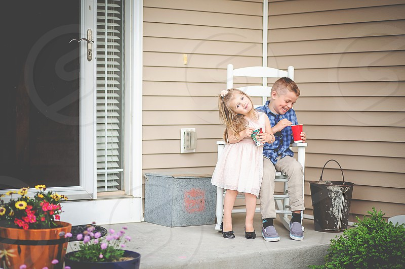 brother and sister snacks front porch laughing smiling girl and boy children photo