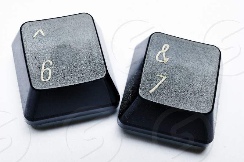 Keys from a computer keyboard with the numbers 67 to spell out retirement photo